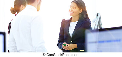 business team talking standing near desktop. office life. ...