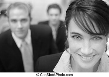 three business people looking at camera staggered on stairs