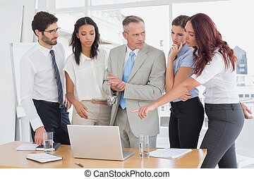Business team using a laptop