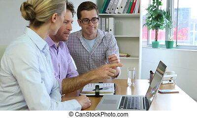 Business team using laptop
