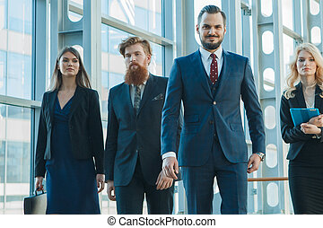 Business team walking in glass building