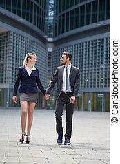 business team walking in urban environment