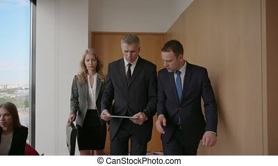 Business team walking with documents