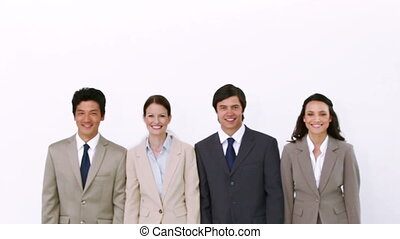 Business team walks and poses against white background