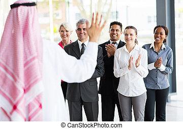 business team welcoming Arabian business partner