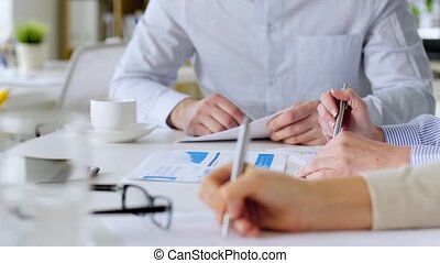 business team with charts at office meeting - business,...
