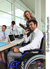business team with colleague in wheelchair