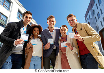 business team with conference badges in city - business and...