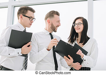 business team with documents discussing business plan
