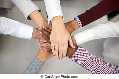 business team with hands on top at office - business,...