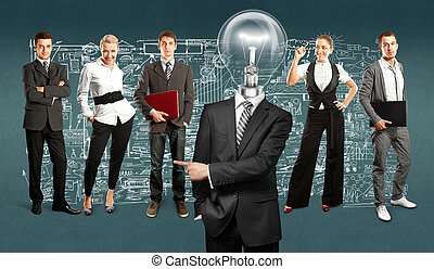 Business Team With Lamp Head - Idea concept. Lamp Head and...