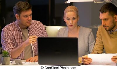 business team with laptop working at night office -...