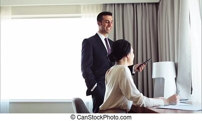 business team with papers and tablet pc at hotel - business,...
