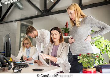 business team with papers in office