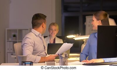 business team with papers working late at office - business,...