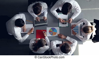Business team with reports