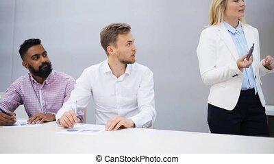 business team with scheme at presentation - teamwork,...