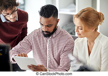 business team with tablet pc computer in office
