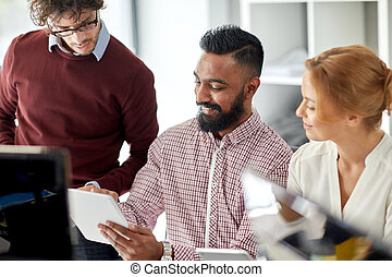 business team with tablet pc computers in office