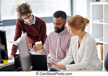 business team with tablet pc in office