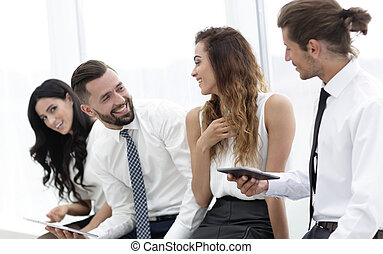 business team with tablet sitting in the office.