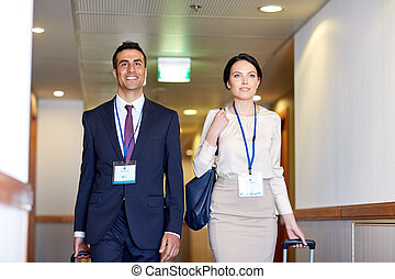 business team with travel bags at hotel corridor