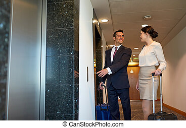 business team with travel bags at hotel elevator