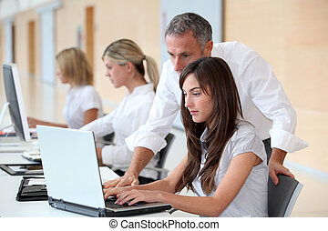 Business team working in the office on laptop computer