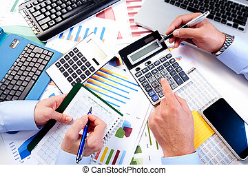 Business team working in the office. - Hand with calculator....