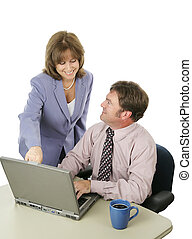 Business Team Working Together - A male and female business...