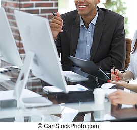business team working together at desk in creative office