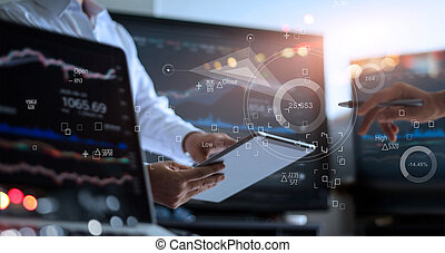 Business team working together. Businessman using tablet for analyzing data stock market in monitoring room with team pointing on the data presented in the chart on icon screen, forex trading graph, stock exchange trading online, financial investment concept. All on laptop screen are design up.