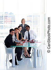 Business team working together in office - International...