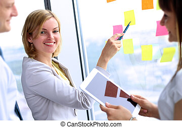 business team working  with   digital tablet and stickers in office
