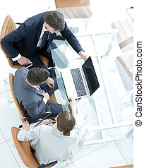 Business team working with laptop at work desk