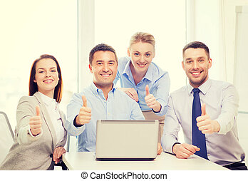 business team working with laptop in office