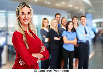 Business team. - Young beautiful business woman over team ...