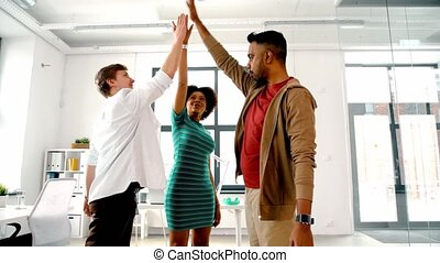 happy creative team making high five at office - business,...