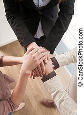 Business teamwork concept, top view of hands joined together, ve
