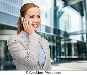 young smiling businesswoman with smartphone - business,...