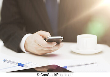 businessman with smartphone reading news
