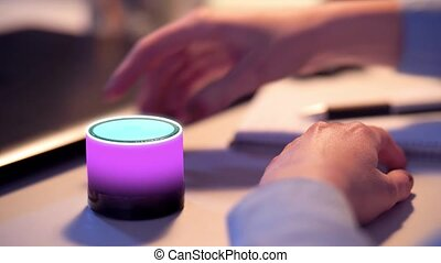 businesswoman using smart speaker at office - business,...