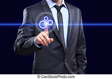 business, technology and internet concept - businessman pressing button with mechanism icon on virtual screens