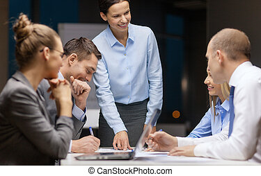 smiling female boss talking to business team - business, ...