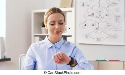 businesswoman with smartphone and smart watch