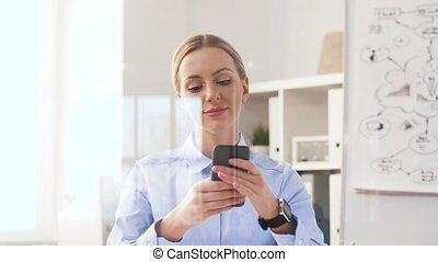 businesswoman with smartphone and smart watch - business,...