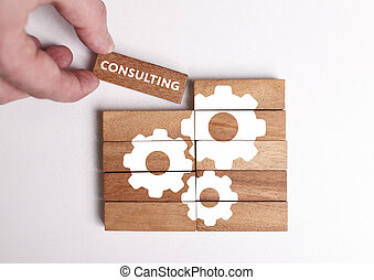 Business, Technology, Internet and network concept. Young businessman shows the word: Consulting