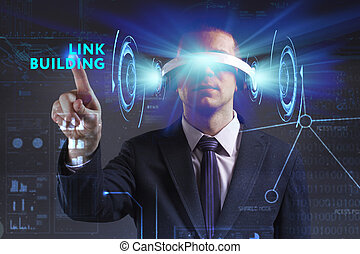 Business, Technology, Internet and network concept. Young businessman working in virtual reality glasses sees the inscription: Link building