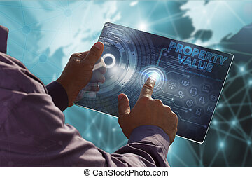 Business, Technology, Internet and network concept . Young business man working on the tablet of the future , select the virtual screen : property value