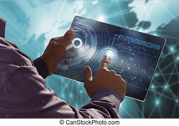 Business, Technology, Internet and network concept . Young business man working on the tablet of the future , select the virtual screen : outsourcing
